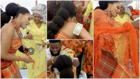 Groom Pulls Off Wife's 'Cloth' During Traditional Wedding Ceremony, Sprays Dollars All Over Her in Video