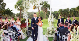Paralyzed football player defies odds, walks down the aisle at his wedding
