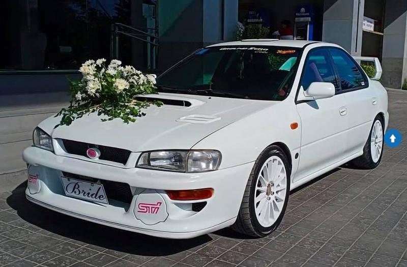 You can rent this Subaru Impreza STI as your wedding car